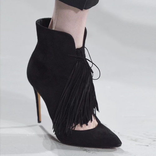 picture of 1 elegant suede pointed toe ankle boot with fashion tassle and a women wearing the boot