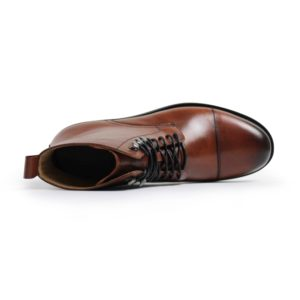 picture of a handmade dapper leather boots lying on its side showing the inside of the boot and the laces