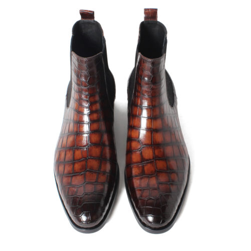 picture of 2 handmade crocodile skin chelsea boots from the birds eye viewpoint