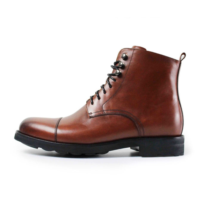 picture of brown handmade dapper leather boots from the side with a white background