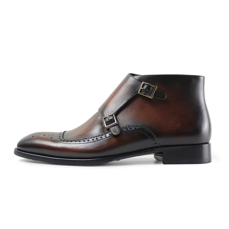 picture of brown retro military chelsea boots with buckle on the front instead of laces
