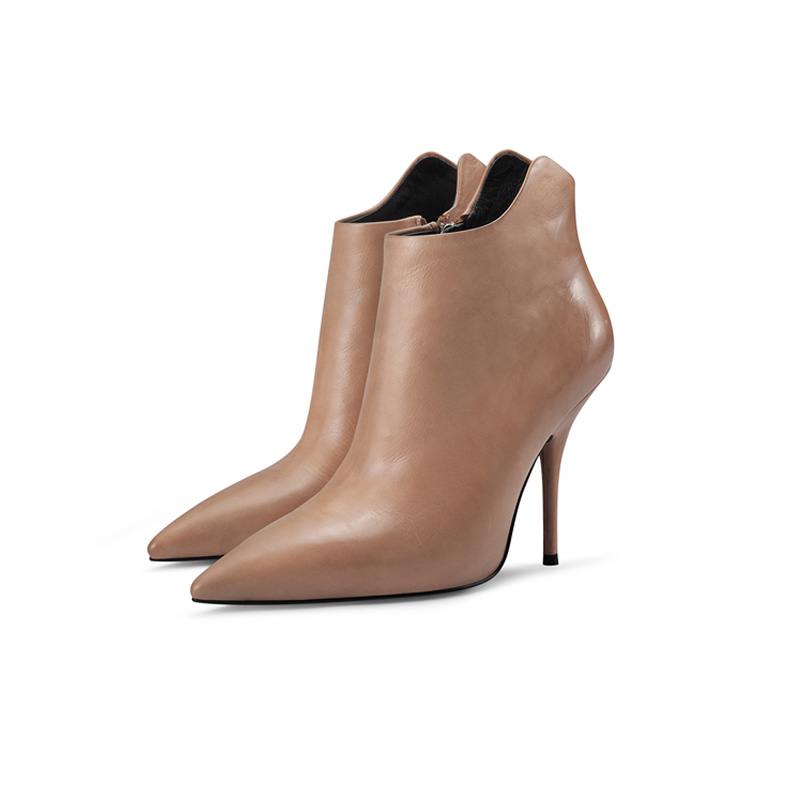 picture of pointed toe high heel boots with zipper on the side on a white background