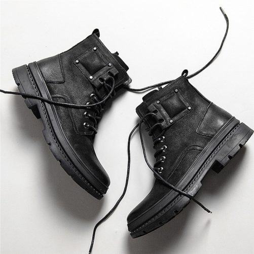 black winter ankle boots that are laying down with the laces undone