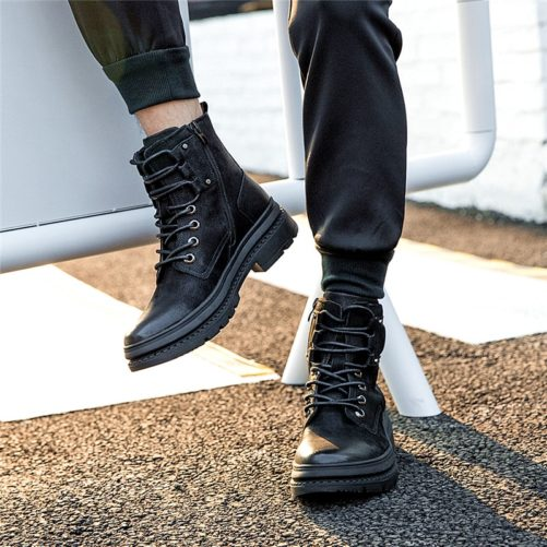 picture of a guy wearing the black ankle winter boots