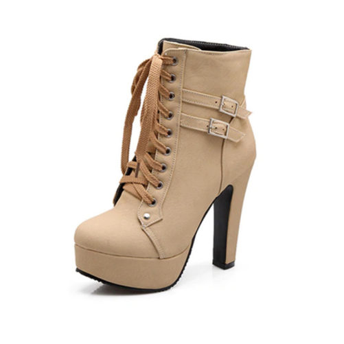 high platform heel ankle boots with buckle that are beige