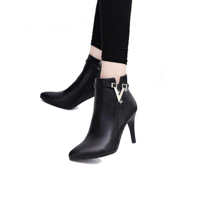 picture of a girl wearing sexy stiletto high heel ankle boots with a v buckle