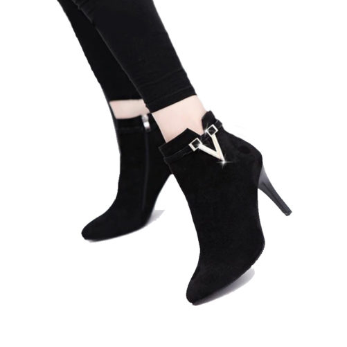 picture of a girl wearing sexy stiletto high heel ankle boots with a v buckle that are black suede