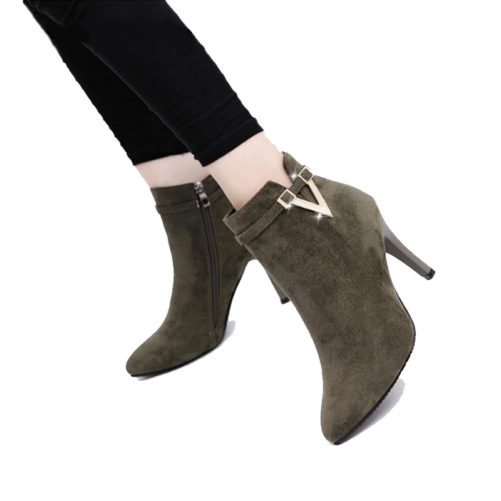 picture of a girl wearing sexy stiletto high heel ankle boots with a v buckle that are green suede