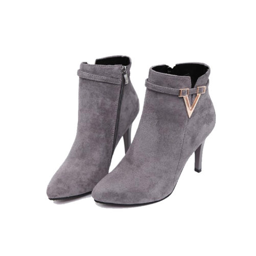 picture of a girl wearing sexy stiletto high heel ankle boots with a v buckle that are grey suede